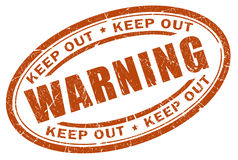 Warning stamp Royalty Free Stock Photography