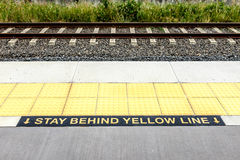 Warning Stay Behind the Yellow Line Royalty Free Stock Images