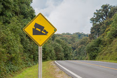 Warning steep road sign and slop Stock Photo