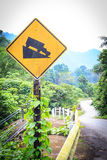 Warning steep road sign slope and truck on hill. Royalty Free Stock Images