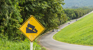 Warning steep road sign slope. And truck on hill royalty free stock photo