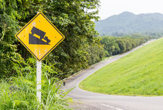 Warning steep road sign slope. And truck on hill stock images
