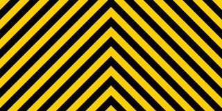 Warning striped rectangular background, yellow and black stripes on diagonal in different directions, a warning to be careful. Warning striped rectangular Royalty Free Stock Image