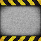Warning stripes background with rusty plate Stock Photo