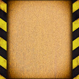 Warning stripes frame with rusty plate Royalty Free Stock Image