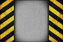 Warning stripes with rusty plate Stock Photo