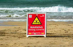 Warning strong currents sign Stock Photography
