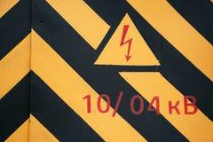 Warning symbol on doors of the transformer Stock Photos