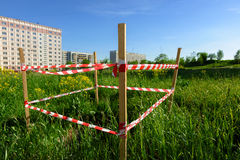 Warning tape attached to a wooden pole Stock Images