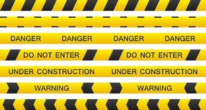 Warning tape set. Set of 7 isolated seamless warning tapes with and without text Royalty Free Stock Images