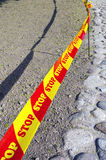 Warning tape stop on the road Royalty Free Stock Images
