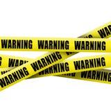 Warning tape. On white background Royalty Free Stock Images