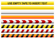 Warning tapes. With a blank one to insert your own text Royalty Free Stock Images