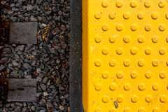 Warning tiles and railway track Royalty Free Stock Images