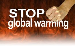 Listen to the Experts and Stop Global Warming. Warning to stop global warming with a clenched fist coming down on the word WARMING against a background of dark stock photography