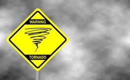 Warning tornado sign road. Yellow hazard warning sign against grey sky   Royalty Free Stock Photography