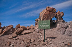 Warning for tourists. On the volcano Teide Royalty Free Stock Photography