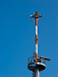 Warning tower with blue sky background. Stock Photo