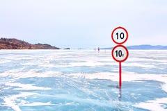 Warning traffic sign on Baikal ice crossing to Olkhon island Royalty Free Stock Photos
