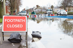 Warning Traffic Sign On Flooded Road Royalty Free Stock Photos