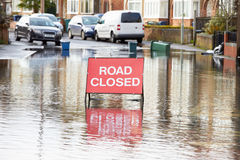 Warning Traffic Sign On Flooded Road Royalty Free Stock Images