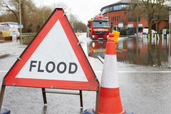 Warning Traffic Sign On Flooded Road With Fire Engine Stock Photo