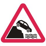 Warning traffic signs, Car falling from the slope into the water Royalty Free Stock Photo
