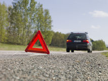 Warning triangle. In front of a car breakdown royalty free stock images