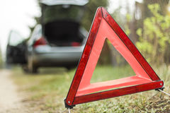 Warning triangle. Broken down car. A broken car on the side. Warning triangle Stock Images