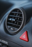 Warning triangle button and air conditioning hole. Royalty Free Stock Photos