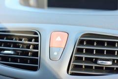 Warning triangle on car dashboard. Warning triangle on the car dashboard. soft focus Stock Image