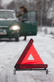 Warning triangle with car on road stock image