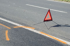 Warning triangle on the road after the car crash Stock Images