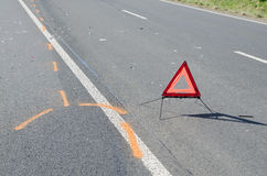 Warning triangle on the road after the car crash Stock Photography
