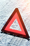 Warning triangle on road Stock Image