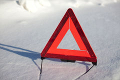Warning triangle on snow Royalty Free Stock Images