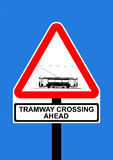 Warning triangle Tramway Crossing Ahead. Road traffic sign Stock Photo