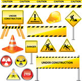Warning and under construction signs Stock Images