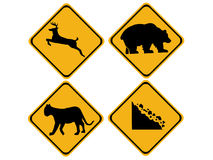 Warning wildlife signs. Deer, bear, puma, falling rocks Royalty Free Stock Image