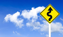 Warning Winding traffic sign with blue sky Stock Photography
