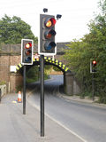 Warnings lights at railway arch. Lots of traffic lights warning for single lane traffic Stock Image