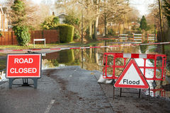 Warnings Signs On Flooded Road Royalty Free Stock Images