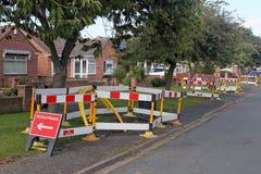 Warnzeichen und Sperren der Straßenarbeiten. Lizenzfreies Stockfoto