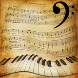 Warped piano and music sheet background. Retro and grunge texture with a warped piano and notes stock photo