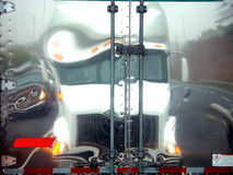 Warped Vision. Distorted reflection of truck on doors stock photography