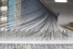 Warping machine in a textile weaving factory Royalty Free Stock Photo