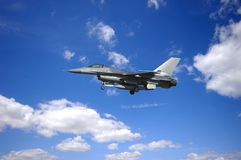 Warplane and clouds Royalty Free Stock Photos