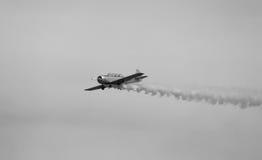 Warplane with dark smoke from the engine Royalty Free Stock Photos