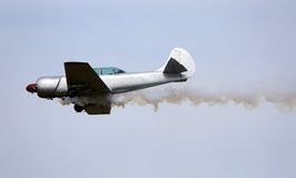 WARPLANE with smoke from the engine Royalty Free Stock Image