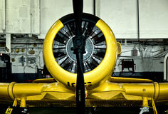 Warplane in Yellow. Airplane caught on presentation in a hangar. Camera used was a Nikon D70S with an 18-70mm lens with flash and ISO200 Royalty Free Stock Images